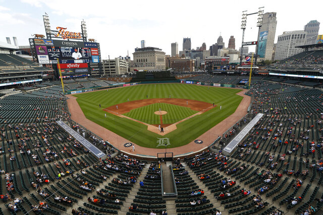 CORRECTS YEAR TO 2019 - FILE - In this Sept. 16, 2019, file photo, fans at Comerica Park watch a baseball game between the Detroit Tigers and the Baltimore Orioles in Detroit. Gov. Gretchen Whitmer is allowing for the return of pro sports in Michigan as long as fans aren't in attendance. The move Thursday, June 25, 2020, follows Major League Baseball's decision this week to set a 60-game schedule to start July 23 or July 24 in empty ballparks. (AP Photo/Paul Sancya, File)