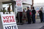 """FILE - In this Feb. 15, 2020, file photo, people wait in line at an early voting location at the culinary workers union hall in Las Vegas. Nevada's Republican Party voted to censure the secretary of state, accusing her of failing to fully investigate allegations of fraud in the 2020 election. Barbara Cegavske says there was no fraud and that her own party is attacking her for refusing to """"put my thumb on the scale of democracy."""" Cegavske, the only Republican statewide office holder in Nevada, said members of her party are disappointed with the election results and believe fraud occurred """"despite a complete lack of evidence to support that belief."""" (AP Photo/John Locher, File)"""