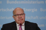 German Economy Minister Peter Altmaier briefs the media about a so called 'stabilization package' for German airline Lufthansa at the economy ministry in Berlin, Germany, Monday, May 25, 2020. (AP Photo/Markus Schreiber, Pool)