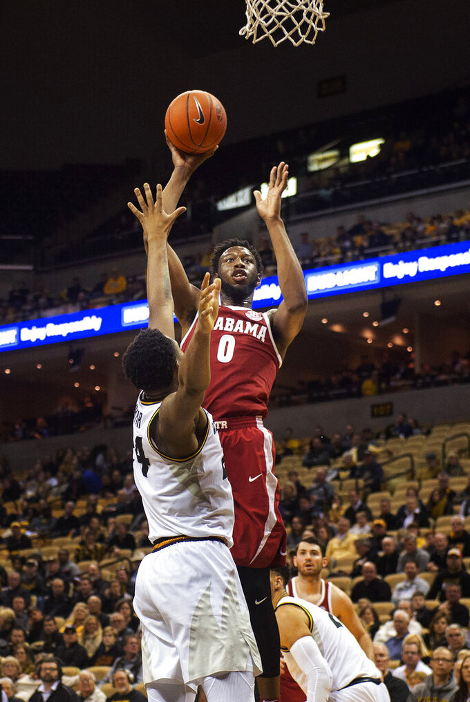 Alabama's Donta Hall, top, shoots over Missouri's Kevin Puryear during the second half of an NCAA college basketball game, Wednesday, Jan. 16, 2019, in Columbia, Mo. Alabama won the game 70-60. (AP Photo/L.G. Patterson)