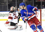 New York Rangers center Ryan Strome (16) celebrates his goal against New Jersey Devils goaltender Cory Schneider (35) during the second period of an NHL hockey game Saturday, March 9, 2019, at Madison Square Garden in New York. (AP Photo/ Bill Kostroun)
