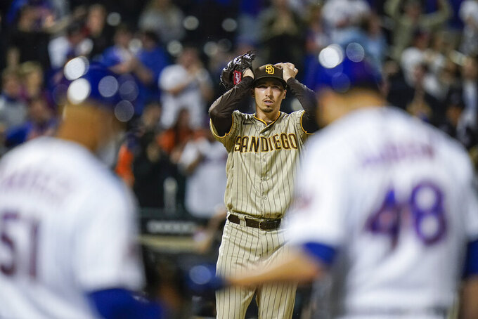 San Diego Padres starting pitcher Blake Snell, center, reacts after New York Mets' Jacob deGrom (48) hit a two-run single during the fifth inning of a baseball game Friday, June 11, 2021, in New York. (AP Photo/Frank Franklin II)