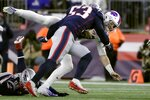 New England Patriots linebacker Kyle Van Noy tackles Buffalo Bills quarterback Josh Allen, rear, in the second half of an NFL football game, Saturday, Dec. 21, 2019, in Foxborough, Mass. (AP Photo/Steven Senne)