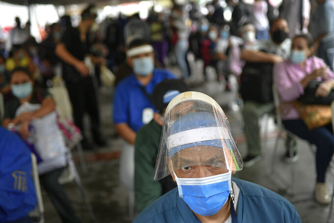 Medical workers with private clinics wait to get their first dose of the Sinovac COVID-19 vaccine in Caracas, Venezuela, Friday, May 28, 2021. (AP Photo/Matias Delacroix)
