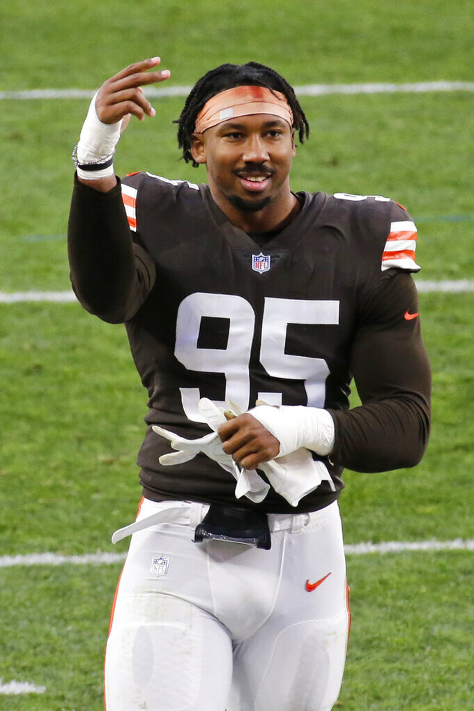 Cleveland Browns defensive end Myles Garrett celebrates after the Browns defeated the Houston Texans in an NFL football game, Sunday, Nov. 15, 2020, in Cleveland. (AP Photo/Ron Schwane)
