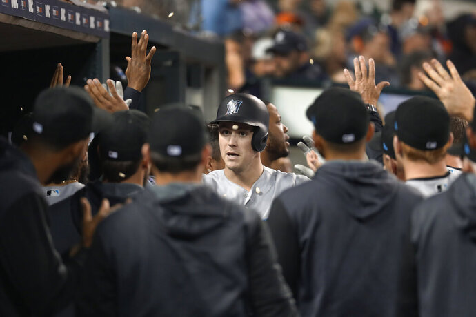 Miami Marlins' Brian Anderson celebrates his two-run home run during the eighth inning of the team's baseball game against the Detroit Tigers in Detroit, Wednesday, May 22, 2019. (AP Photo/Paul Sancya)