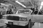 FILE - In this Aug. 6, 1980, file photo, Chrysler Chairman Lee Iacocca, right, waves as he steps into the first K-Car at ceremonies in Detroit, Mich. The new front-wheel-drive compact was the driven out of the plant past cheering auto workers by Iacocca. Former Chrysler CEO Iacocca, who became a folk hero for rescuing the company in the '80s, has died, former colleagues said Tuesday, July 2, 2019. He was 94. (AP Photo/Dale Atkins, File)