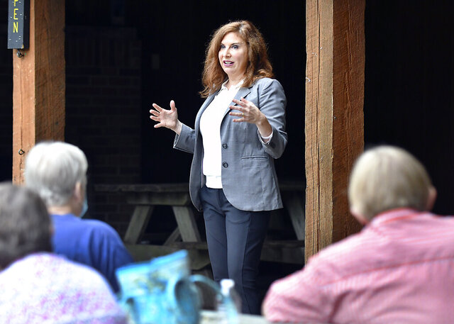 U.S. 5th Congressional District candidate Christina Hale speaks at Mounds State Park Sept. 2, 2020 during a Meet & Greet sponsored by One Nation Indivisible Madison County.  Republican Victoria Spartz, a state senator from Noblesville, is facing  Hale, a former state representative from Indianapolis, in a race that's drawn millions of dollars in campaign spending and could show whether the national trend of suburban women away from Republicans under President Donald Trump extends enough to shift the Indiana seat. (John P. Cleary/The Herald Bulletin via AP)