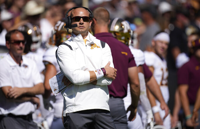 Minnesota head coach P.J. Fleck looks on during the first half of an NCAA college football game against Colorado, Saturday, Sept. 18, 2021, in Boulder, Colo. (AP Photo/David Zalubowski)