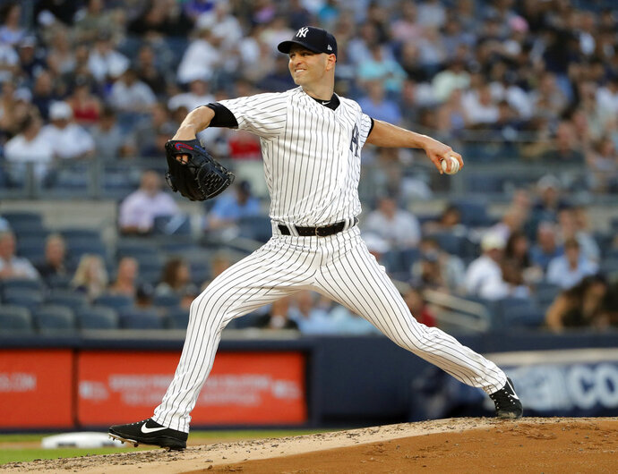FILE - In this Aug. 9, 2018, file photo, New York Yankees starting pitcher J.A. Happ delivers against the Texas Rangers during the second inning of a baseball game, in New York. Left-hander J.A. Happ and the New York Yankees have finalized a $34 million, two-year contract. Happ gets $17 million in each of the next two seasons, and his deal includes a $17 million option for 2021 that could become guaranteed based on starts and innings in 2020. (AP Photo/Julie Jacobson, File)