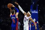 Detroit Pistons' Luke Kennard (5) shoots as Philadelphia 76ers' Tobias Harris defends during the second half of an NBA preseason basketball game Tuesday, Oct. 15, 2019, in Philadelphia. The 76ers won 106-86. (AP Photo/Matt Rourke)