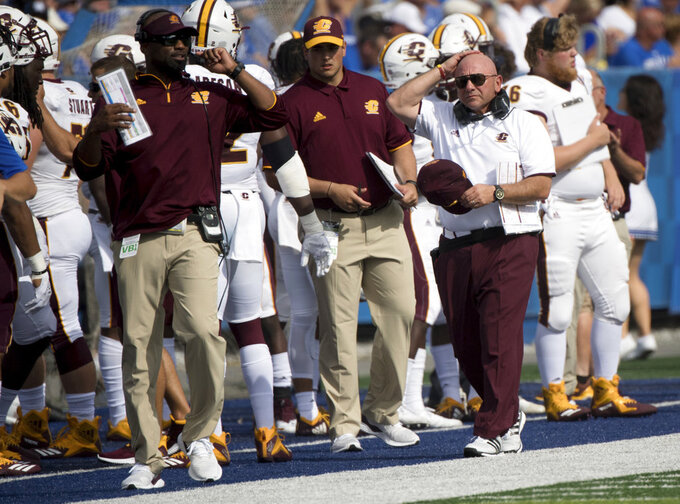 Central Michigan head coach John Bonamego, right, paces the sideline during the first half of an NCAA college football game against Kentucky in Lexington, Ky., Saturday, Sept. 1, 2018. (AP Photo/Bryan Woolston)