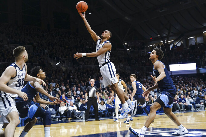Butler guard Aaron Thompson (2) shoots in front of Villanova forward Jeremiah Robinson-Earl, right, during the first half of an NCAA college basketball game in Indianapolis, Wednesday, Feb. 5, 2020. (AP Photo/AJ Mast)
