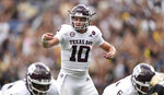 Texas A&M quarterback Zach Calzada directs his teammates in the second half of an NCAA college football game against Colorado, Saturday, Sept. 11, 2021, in Denver. Texas A&M won 10-7. (AP Photo/David Zalubowski)