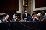 Sen. Joshua Hawley, R-Mo., left, and Sen. Ben Sasse, R-Neb., speak with aides during a Senate Judiciary Committee business meeting to consider authorization for subpoenas relating to the Crossfire Hurricane investigation, and other matters on Capitol Hill in Washington, Thursday, June 11, 2020. (Erin Schaff/The New York Times via AP, Pool)