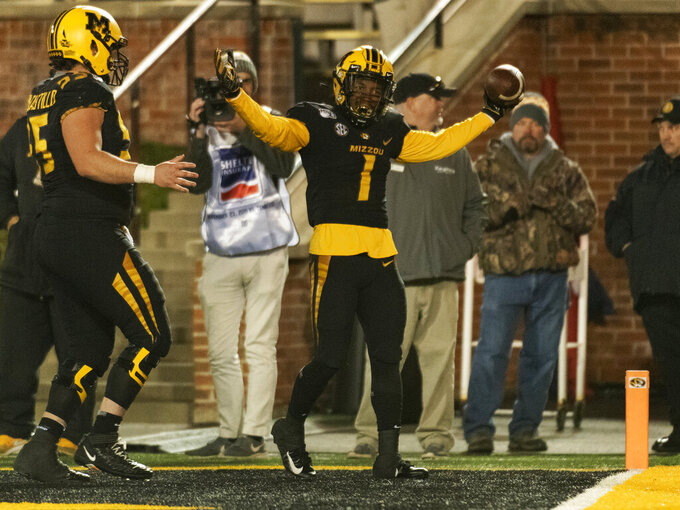Missouri running back Tyler Badie, right, celebrates his touchdown with teammate Trystan Colon-Castillo, left, during the third quarter of an NCAA college football game against Tennessee, Saturday, Nov. 23, 2019, in Columbia, Mo. (AP Photo/L.G. Patterson)
