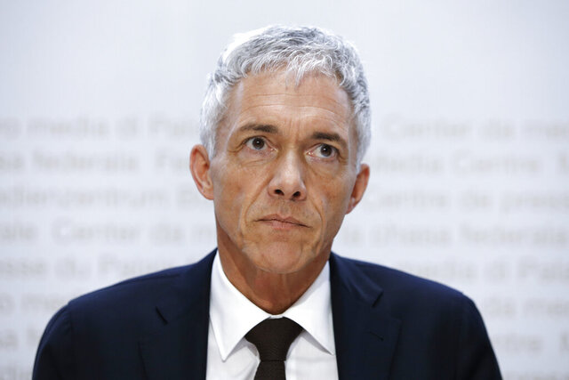 In this Friday, May 10, 2019 FILE photo, Swiss Federal Attorney Michael Lauber watches during a media conference at the Media Centre of the Federal Parliament in Bern, Switzerland. According to media reports, Lauber offered his resignation on 24 July 2020 amid impeachment proceedings over his handling of the FIFA corruption probe. (Peter Klaunzer/Keystone via AP)