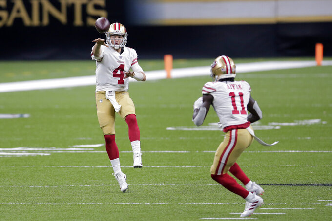 San Francisco 49ers quarterback Nick Mullens (4) passes to wide receiver Brandon Aiyuk (11) in the first half of an NFL football game against the New Orleans Saints in New Orleans, Sunday, Nov. 15, 2020. (AP Photo/Brett Duke)