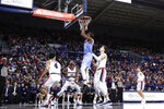 San Diego forward James Jean-Marie, center, shoots in front of Gonzaga forward Filip Petrusev, center right, during the first half of an NCAA college basketball game in Spokane, Wash., Thursday, Feb. 27, 2020. (AP Photo/Young Kwak)