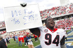 Georgia defensive tackle Michael Barnett (94) celebrates after winning an NCAA football game between Georgia and Georgia Tech on Saturday, Nov. 30, 2019, in Atlanta. Georgia won 52-7. (Joshua L. Jones/Athens Banner-Herald via AP)