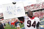 Georgia defensive tackle Michael Barnett (94) celebrates after winning an NCAA football game between Georgia and Georgia Tech on Saturday, Nov. 30, 2019, in Atlanta. Georgia won 52-7. (Joshua L. Jones/Athens Banner-Herald via AP)