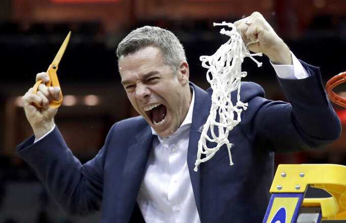 Virginia head coach Tony Bennett celebrates after defeating Purdue 80-75 in overtime of the men's NCAA Tournament college basketball South Regional final game, Saturday, March 30, 2019, in Louisville, Ky. (AP Photo/Michael Conroy)