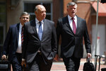 The defense team for Paul Manafort, including Kevin Downing, right, Thomas Zehnle, center, and Richard Westling walk to federal court during the trial of the former Trump campaign chairman, Friday, Aug. 10, 2018, in Alexandria, Va. (AP Photo/Evan Vucci)