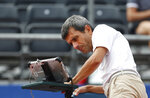 Tennis umpire Carlos Ramos checks the equipment on the umpires chair just prior to the start of a Davis Cup semifinal singles match between Croatia and the United States in Zadar, Croatia, Friday, Sept. 14, 2018. (AP Photo/Darko Bandic)