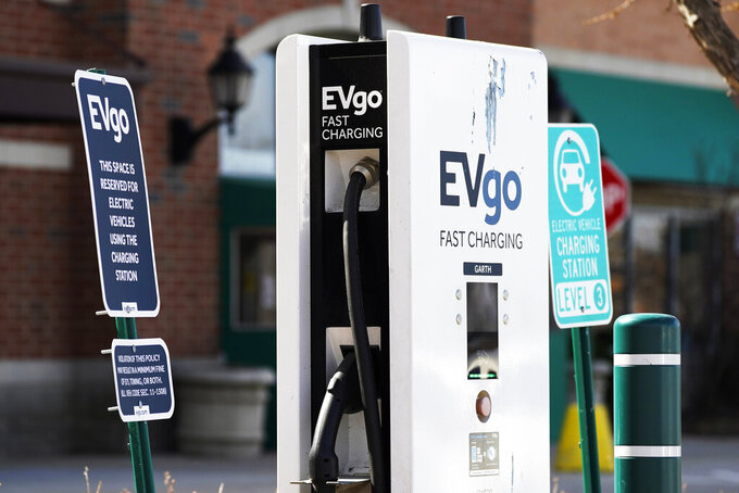A EVgo electric vehicle charging station is seen at Willow Festival shopping plaza parking lot in Northbrook, Ill., Wednesday, March 31, 2021. President Joe Biden will unveil his $2 trillion infrastructure plan and the proposal calls to build a national network of 500,000 electric vehicle chargers by 2030 and replace 50,000 diesel public transit vehicles. (AP Photo/Nam Y. Huh)