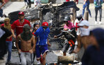 Anti-government protesters clash with security forces as they show support for a mutiny by a National Guard unit in the Cotiza neighborhood of Caracas, Venezuela, Monday, Jan. 21, 2019. Venezuela's government said Monday it put down the mutiny. (AP Photo/Fernando Llano)