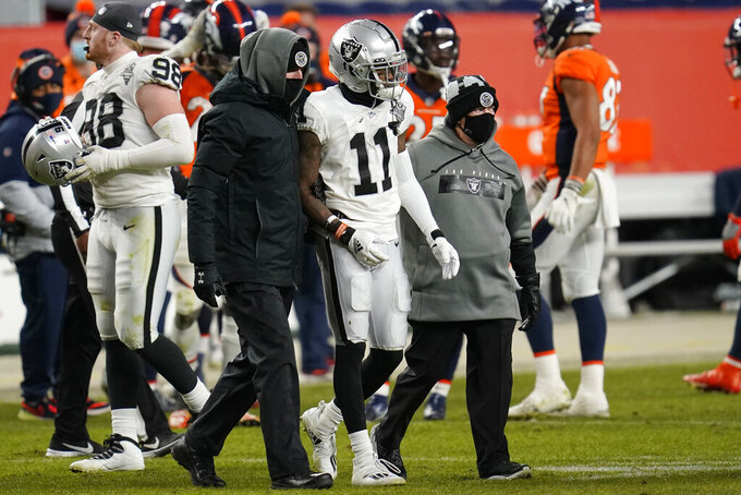 Las Vegas Raiders wide receiver Henry Ruggs III (11) is helped off the field after a play against the Denver Broncos during the second half of an NFL football game, Sunday, Jan. 3, 2021, in Denver. (AP Photo/David Zalubowski)