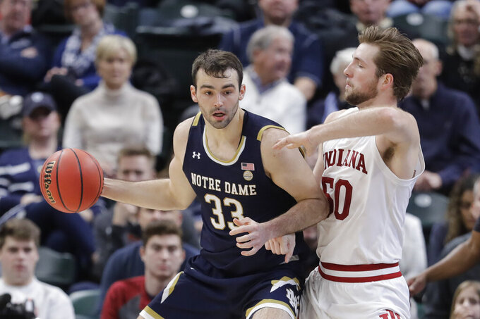 Notre Dame's John Mooney (33) is defended by Indiana's Joey Brunk (50) during the second half of an NCAA college basketball game, Saturday, Dec. 21, 2019. Indiana won 62-60 (AP Photo/Darron Cummings)