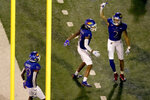 Kansas wide receiver Lawrence Arnold (2) celebrates with wide receivers Kwamie Lassiter II (8) and Steven McBride (19) after scoring a touchdown during the first half of an NCAA college football game against South Dakota Friday, Sept. 3, 2021, in Lawrence, Kan. (AP Photo/Charlie Riedel)