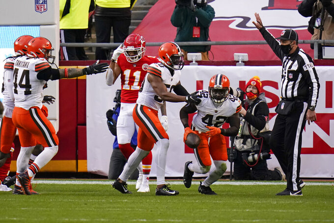 Cleveland Browns safety Karl Joseph (42) celebrates with teammates after intercepting a pass in the end zone during the second half of an NFL divisional round football game against the Kansas City Chiefs, Sunday, Jan. 17, 2021, in Kansas City. (AP Photo/Jeff Roberson)