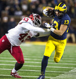Indiana linebacker Dameon Willis Jr. (43) forces Michigan running back Tru Wilson (13) out of bounds in the third quarter of an NCAA college football game in Ann Arbor, Mich., Saturday, Nov. 17, 2018. Michigan won 31-20. (AP Photo/Tony Ding)