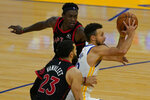 Golden State Warriors guard Stephen Curry, right, drives against Toronto Raptors guard Fred VanVleet (23) and forward Pascal Siakam during the second half of an NBA basketball game in San Francisco, Sunday, Jan. 10, 2021. (AP Photo/Jeff Chiu)