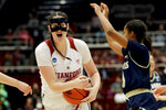 Stanford center Shannon Coffee, left, pulls a rebound away form UC Davis forward Nina Bessolo during the first half of a first-round game in the NCAA women's college basketball tournament in Stanford, Calif. Saturday, March 23, 2019. (AP Photo/Chris Carlson)