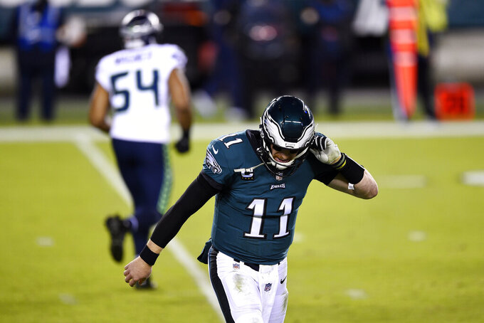 Philadelphia Eagles' Carson Wentz walks off the field during the first half of an NFL football game against the Seattle Seahawks, Monday, Nov. 30, 2020, in Philadelphia. (AP Photo/Derik Hamilton)