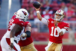 San Francisco 49ers quarterback Jimmy Garoppolo (10) passes against the Arizona Cardinals during the second half of an NFL football game in Santa Clara, Calif., Sunday, Nov. 17, 2019. (AP Photo/John Hefti)