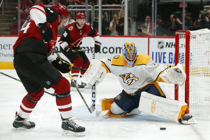 Nashville Predators goaltender Juuse Saros makes a save on Arizona Coyotes center Carl Soderberg (34) during the second period of an NHL hockey game Thursday, Oct. 17, 2019, in Glendale, Ariz. (AP Photo/Rick Scuteri)