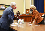 Dr. Anthony Fauci, director of the National Institute for Allergy and Infectious Diseases, speaks with Rep. Carolyn Maloney, D-N.Y., right, after a House Subcommittee on the Coronavirus crisis hearing, Friday, July 31, 2020 on Capitol Hill in Washington. (Kevin Dietsch/Pool via AP)