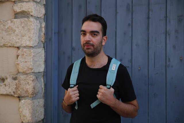 Actor and theater director Aris Laskos poses outside the Theater of Neos Kosmos in Athens, Thursday, Oct. 1, 2020. Laskos based in Athens, hasn't worked since early February and received a one-off support check for 800 euros ($940) shortly after the country's economy was placed in lockdown in the spring due to the pandemic. (AP Photo/Thanassis Stavrakis)