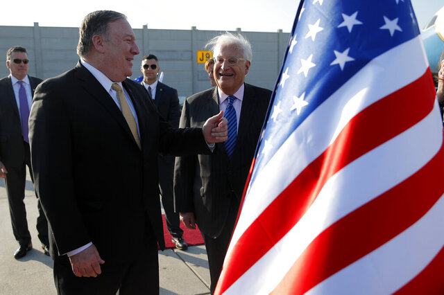 FILE - In this March 20, 2019, file photo, U.S. Secretary of State Mike Pompeo meets U.S. Ambassador to Israel David Friedman upon his arrival at Ben Gurion International Airport, near Tel Aviv, Israel. The U.S. State Department has put the ambassador to Israel's official residence outside Tel Aviv up for sale, in a decision aimed at cementing the American embassy's controversial move to Jerusalem. The beachfront mansion in the affluent Tel Aviv suburb of Herzliya is going on the market because most of Ambassador David Friedman's day-to-day activities are based at the embassy in Jerusalem, the State Department said Tuesday, June 30, 2020. (Jim Young/Pool Photo via AP, File)