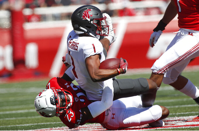 Utah cornerback Faybian Marks (23) tackles Washington State wide receiver Travell Harris (1) in the first half, of an NCAA college football game Saturday, Sept. 25, 2021, in Salt Lake City, Utah. (AP Photo/George Frey)