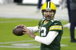 Green Bay Packers' Aaron Rodgers warms up before an NFL football game against the Chicago Bears Sunday, Nov. 29, 2020, in Green Bay, Wis. (AP Photo/Mike Roemer)