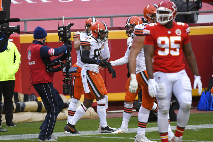 Cleveland Browns wide receiver Jarvis Landry, center, celebrates with teammates after catching a 4-yard touchdown pass during the second half of an NFL divisional round football game against the Kansas City Chiefs, Sunday, Jan. 17, 2021, in Kansas City. (AP Photo/Reed Hoffmann)