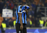 Inter Milan's Romelu Lukaku covers his face end of the Champions League, group F soccer match between Inter Milan and F.C. Barcelona, at the San Siro stadium in Milan, Italy, Tuesday, Dec. 10, 2019. Barcelona won 2-1. (AP Photo/Luca Bruno)