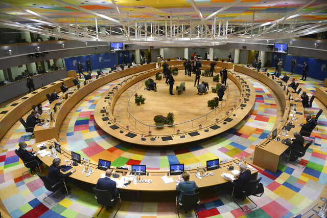 A general view of the round table meeting at an EU summit at the European Council building in Brussels, Thursday, Oct. 1, 2020. European Union leaders are meeting to address a series of foreign affairs issues ranging from Belarus to Turkey and tensions in the eastern Mediterranean. (Johanna Geron, Pool via AP)