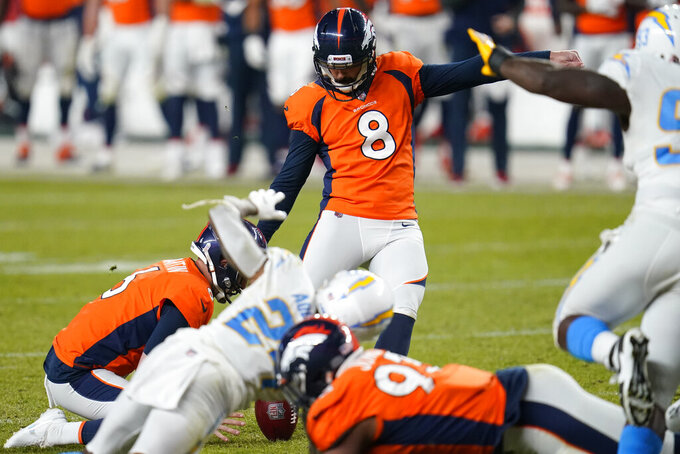 Denver Broncos kicker Brandon McManus (8) kicks the game-winning point after against the Los Angeles Chargers during the second half of an NFL football game, Sunday, Nov. 1, 2020, in Denver. The Broncos won 31-30. (AP Photo/David Zalubowski)