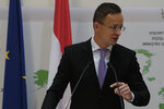 Hungarian Minister of Foreign Affairs and Trade Peter Szijjarto speaks during a news conference after a meeting with Cyprus' Foreign Minister Nikos Christodoulides at the Cypriot foreign ministry on Friday, June 26, 2020. Szijjarto is in Cyprus for one-day visit. (AP Photo/Petros Karadjias)